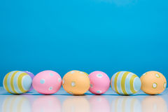 Painted Easter eggs with copy space on background Royalty Free Stock Photos