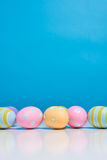 Painted Easter eggs with copy space on background Royalty Free Stock Images