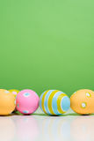 Painted Easter eggs with copy space on background Stock Photos