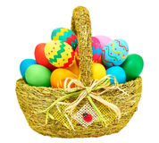Painted Easter Eggs in decorated Basket on white background Royalty Free Stock Photo