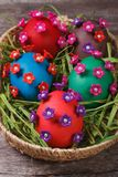 Painted Easter eggs decorated with flowers with pearls Royalty Free Stock Photos