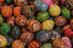 Painted Easter eggs. Painted eggs are decorated by various techniques before Easter.The imitation of painted eggs are made of wood on the picture,covered by Royalty Free Stock Images
