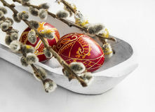 Painted Easter eggs decoration with spring buds branches Royalty Free Stock Images