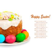 Painted Easter eggs and delicious cupcake on isolated back Royalty Free Stock Image