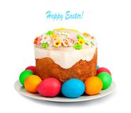 Painted Easter eggs and delicious cupcake on white isolated. Background Stock Photo