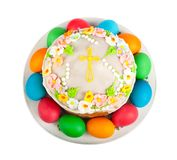 Painted Easter eggs and delicious cupcake on white isolated Stock Image
