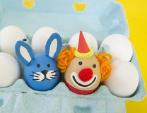 Circus.The concept of Easter with cute and cheerful handmade eggs. Painted Easter eggs in different moods and facial expression The concept of Easter with cute Stock Photography