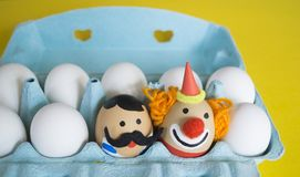 Circus.The concept of Easter with cute and cheerful handmade eggs. Painted Easter eggs in different moods and facial expression The concept of Easter with cute Stock Photo