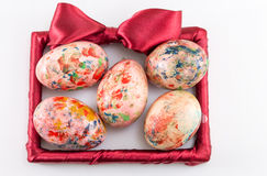 Painted easter eggs in a frame Royalty Free Stock Photography