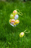 Painted easter eggs in glass on green grass Stock Photo
