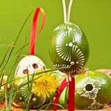 Painted easter eggs. On the green background stock photo