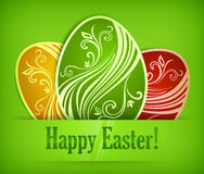 Painted Easter eggs on green & text Royalty Free Stock Photos