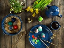 Painted easter eggs while having coffee royalty free stock photos