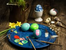 Painted easter eggs while having coffee royalty free stock images