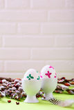 Painted Easter eggs in holders and willow Royalty Free Stock Photography