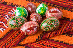 Painted Easter eggs laying on towel Stock Photos