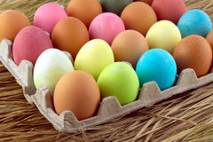 Painted Easter eggs lie in rows inside cells on a  Royalty Free Stock Image