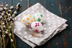 Painted Easter eggs on napkin and pussy willow branches Stock Photos