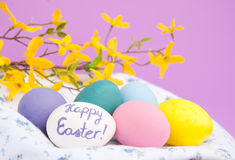 Painted Easter eggs nested in white cloth Royalty Free Stock Image