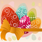 Painted easter eggs and orange bow Stock Images