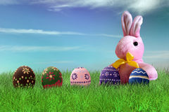 Painted Easter eggs and pink bunny stock photography