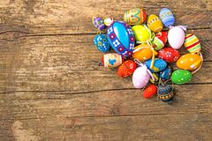 Painted easter eggs on a plank. With copy space Royalty Free Stock Photography