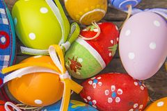 Painted easter eggs on a plank. Painted easter eggs on a wooden plank Royalty Free Stock Image