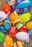 Painted easter eggs on a plank. Painted easter eggs on a wooden plank Stock Images