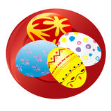 Painted Easter eggs on red plate Royalty Free Stock Image