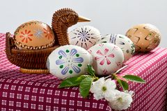 Painted Easter eggs. On the red tablecloth royalty free stock photo