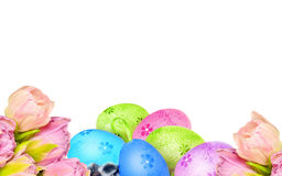 Painted Easter eggs and rose flowers in bloom Stock Photo
