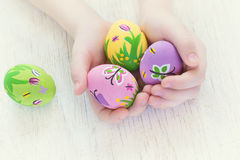 Painted Easter eggs with spring pictures in a child's hands Royalty Free Stock Photo