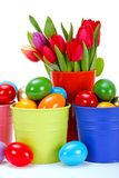 Painted Easter eggs and tulips Stock Photo