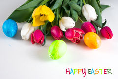 Painted easter eggs with tulips Royalty Free Stock Photos