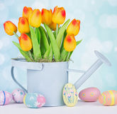Painted Easter Eggs and Tulips Stock Photography
