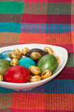 Painted Easter eggs in a white bowl on the kitchen tablecloth Stock Photo