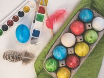 Painted easter eggs on a white, wooden table royalty free stock images