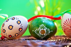 Painted easter eggs. In the wicker basket in the grass stock photo