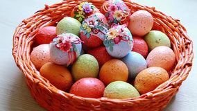 Painted easter eggs in wicker basket stock video footage