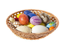 Painted Easter eggs wicker dish table decoration Stock Photo