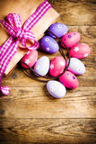Painted Easter eggs on wooden background. Stock Photo