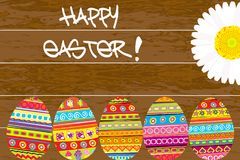 Painted Easter eggs on wooden background Royalty Free Stock Photo