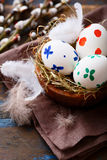 Painted Easter eggs in a wooden bowl Royalty Free Stock Images