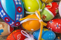 Painted easter eggs on a plank. Painted easter eggs on a wooden plank Royalty Free Stock Photo