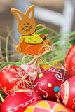 Painted Easter eggs, wooden rabbit royalty free stock photography