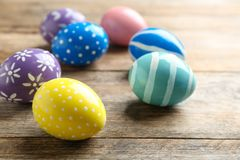 Painted Easter eggs on wooden table. Space for text stock image