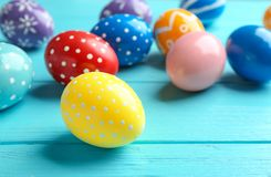 Painted Easter eggs on wooden table. Space for text royalty free stock photo