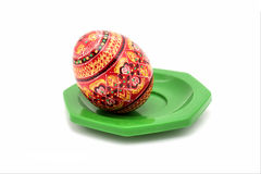 Painted egg on a plate Stock Photos