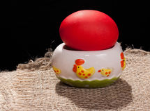 Painted egg on stand. Painted egg for Easter holiday at the white house ornament Chicks royalty free stock image