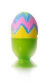 Painted egg in a stand Stock Images